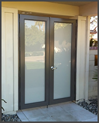 Double walk through gate with frosted glass bronze frame